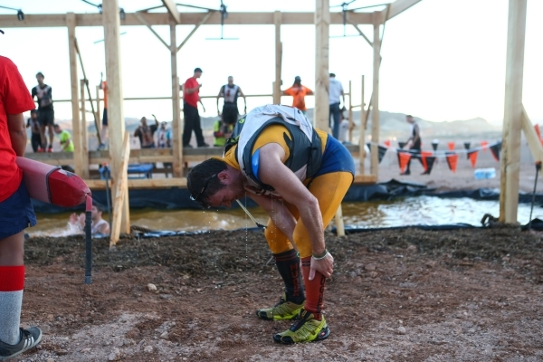 A competitor takes a brief break during the World's Toughest Mudder competition in Lake Las Vegas on Saturday, Nov. 14, 2015. Chase Stevens/Las Vegas Review-Journal Follow @csstevensphoto