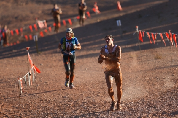 A competitor uses dirt to dry off during the World's Toughest Mudder competition in Lake Las Vegas on Saturday, Nov. 14, 2015. Chase Stevens/Las Vegas Review-Journal Follow @csstevensphoto