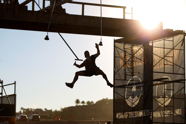 A competitor flies through the air at an obstacle course during the World's Toughest Mudder competition in Lake Las Vegas on Saturday, Nov. 14, 2015. Chase Stevens/Las Vegas Review-Journal F ...
