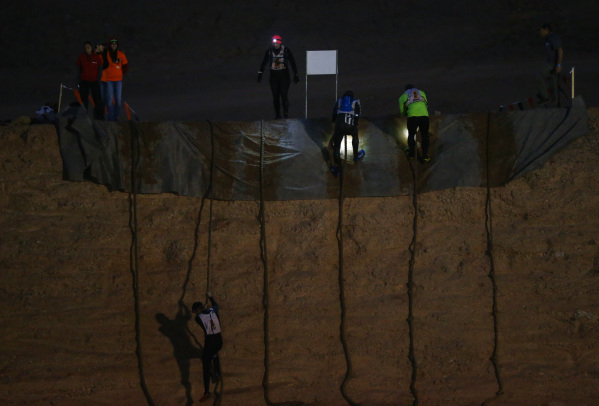 Competitors climb down using ropes during the World's Toughest Mudder competition in Lake Las Vegas on Saturday, Nov. 14, 2015. Chase Stevens/Las Vegas Review-Journal Follow @csstevensphoto