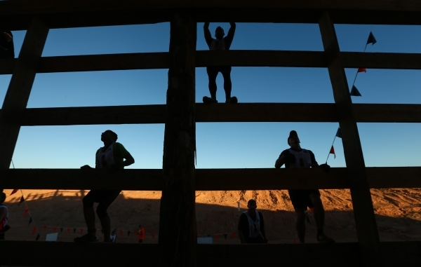 Competitors climb up wooden planks during the World's Toughest Mudder competition in Lake Las Vegas on Saturday, Nov. 14, 2015. Chase Stevens/Las Vegas Review-Journal Follow @csstevensphoto