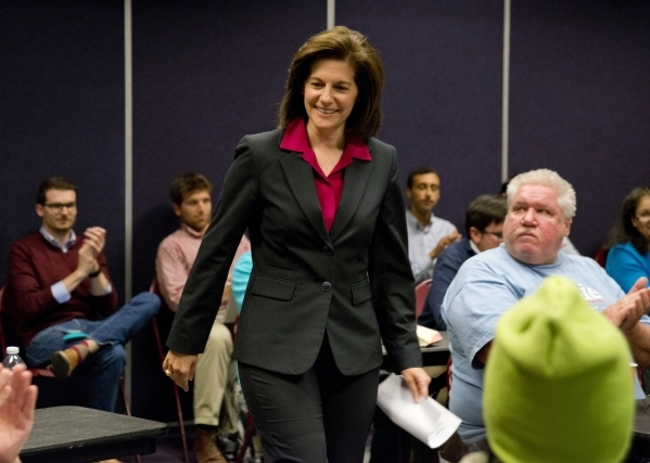 Former Nevada Attorney General Catherine Cortez Masto walks toward the front of the room during an event at the Cambridge Recreation Center in Las Vegas marking 100 days until the Democratic caucu ...