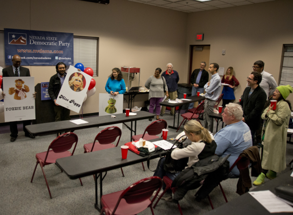 Representatives explain the merits of their candidates during a mock caucus event at the Cambridge Recreation Center in Las Vegas marking 100 days until the Democratic caucus on Friday, Nov. 12 20 ...