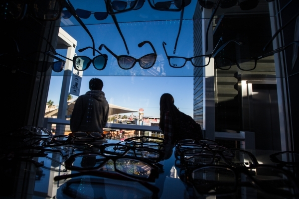 People pass by Monocle Optical on the third floor of the Container Park in downtown Las Vegas on Thursday, Nov. 12, 2015. Chase Stevens/Las Vegas Review-Journal Follow @csstevensphoto