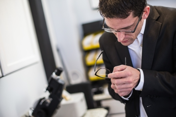 Eric Healey, owner of Monocle Optical, works on a pair of glasses at his business on the third floor of the Container Park in downtown Las Vegas on Thursday, Nov. 12, 2015. Chase Stevens/Las Vegas ...