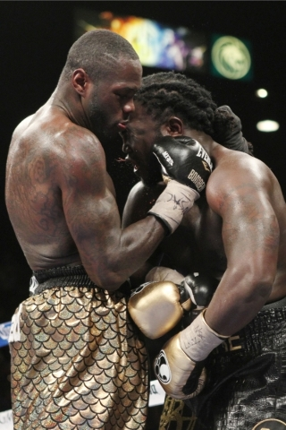 Deontay Wilder, left, connects with Bermane Stiverne during their WBC heavyweight title bout at the MGM Grand Garden Arena in Las Vegas Saturday, Jan. 17, 2015. (Erik Verduzco/Las Vegas Review-Jou ...