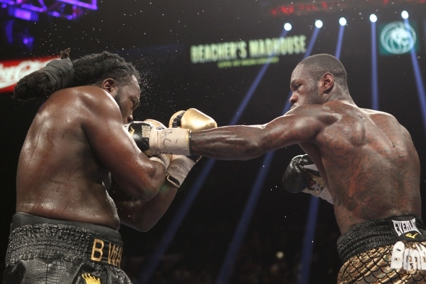Deontay Wilder, right, connects with Bermane Stiverne during their WBC heavyweight title bout at the MGM Grand Garden Arena in Las Vegas Saturday, Jan. 17, 2015. Wilder won by unanimous decision.  ...