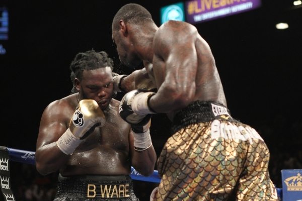 Deontay Wilder, right, connects with Bermane Stiverne during their WBC heavyweight title bout at the MGM Grand Garden Arena in Las Vegas Saturday, Jan. 17, 2015. (Erik Verduzco/Las Vegas Review-Jo ...