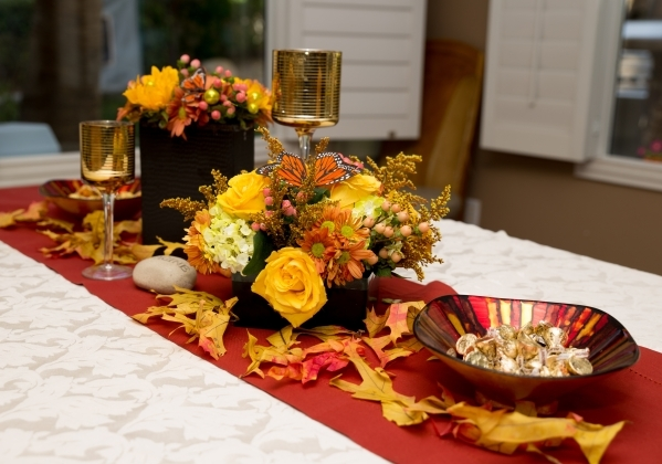 Hileah Cleveland, owner of Sun City-Summerlin Florist, created this colorful Thanksgiving tablescape using flowers and leaves. COURTESY OF TONYA HARVEY