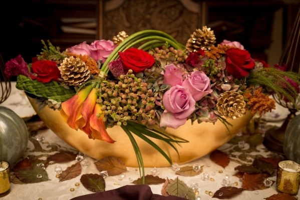 Gold-tipped pine cones highlight this floral centerpiece created by Hileah Cleveland, owner of Sun City-Summerlin Florist. COURTESY OF TONYA HARVEY