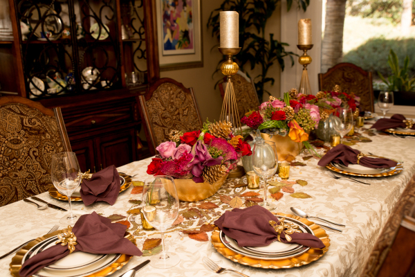 Hileah Cleveland, owner of Sun City-Summerlin Florist, created this formal Thanksgiving tablescape using flowers, pine cones and leaves. COURTESY OF TONYA HARVEY