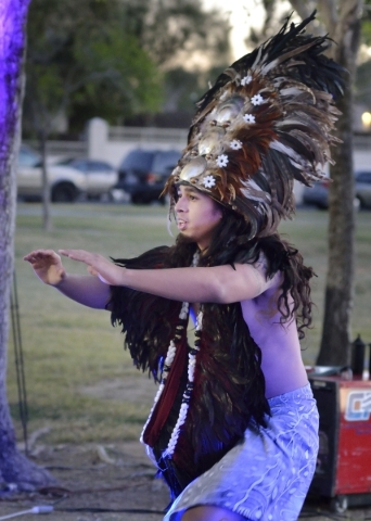 Brendan Leu, a performer with Hot Lava, dances during a luau celebrating the announcement of Natalia RuizþÄôs Make-A-Wish Foundation trip to Hawaii at Lewis Park at 1970 Tree Line Drive i ...