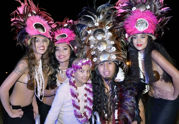 Natalia Ruiz, in white, is shown with Hot Lava performers, from left, Tatiana Pacheco, Hokulani Keali'inohomoku, Brendan Leu and Hokulani Perez during a luau celebrating the announcement of  ...