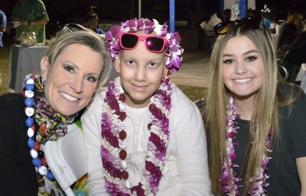 Wish granters Jackie Katz, left, and her daughter Jules, right, are shown with Natalia Ruiz during a luau celebrating the announcement of RuizþÄôs Make-A-Wish Foundation trip to Hawaii at ...