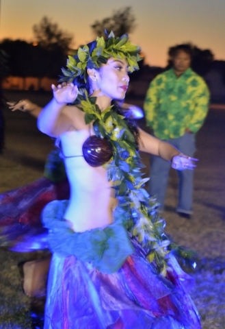 Hokulani Keali'inohomoku of Hot Lava performs during a luau celebrating the announcement of Natalia RuizþÄôs Make-A-Wish Foundation trip to Hawaii at Lewis Park at 1970 Tree Line Dr ...