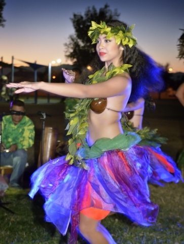 Hokulani Perez of Hot Lava performs during a luau celebrating the announcement of Natalia RuizþÄôs Make-A-Wish Foundation trip to Hawaii at Lewis Park at 1970 Tree Line Drive in Las Vegas ...