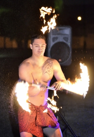 Nainoa George of Hot Lava performs during a luau celebrating the announcement of Natalia RuizþÄôs Make-A-Wish Foundation trip to Hawaii at Lewis Park at 1970 Tree Line Drive in Las Vegas  ...
