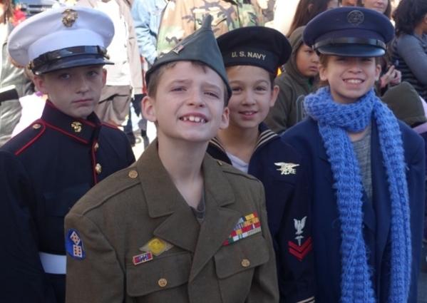 Attending Wednesday's Veterans Day Parade in downtown Las Vegas were siblings Graedyn Graan, in front, and, from left, Sage Graan, Abigail Hubert and Natalie Hubert.  (Norm Clarke/Las Vegas  ...