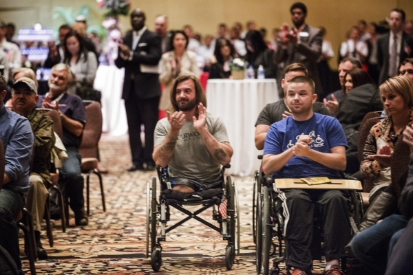 "Wound Warriors and guest clap during the ""Salute the Troops"" event at the The Mirage on Friday, Nov. 13, 2015. MGM Resorts International is treating more than 70 wounded warriors who suf ..."