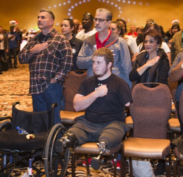"Wounded Warrior Kevin Trimble and other guest  during Presentation of the Colors at the ""Salute the Troops"" event at the The Mirage on Friday, Nov. 13, 2015. MGM Resorts International is ..."