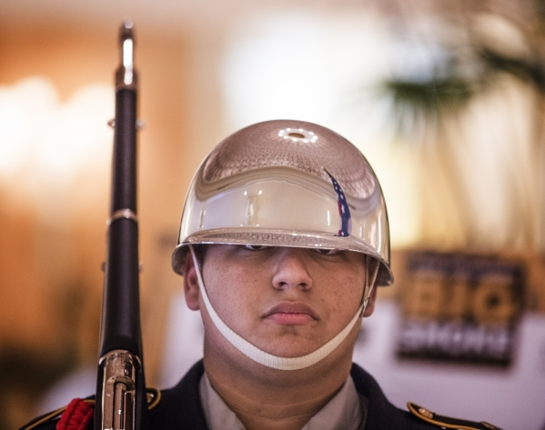 "Tom Elias with the  Valley High School JRROTC stands to attention during the ""Salute the Troops"" event at the The Mirage on Friday, Nov. 13, 2015.MGM Resorts International is treating mo ..."