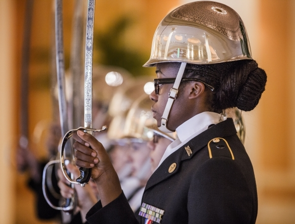 "Alexandra Brown and the  Valley High School JRROTC stands to attention during the ""Salute the Troops"" event at the The Mirage on Friday, Nov. 13, 2015.MGM Resorts International is treati ..."