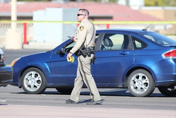 Police investigate a suicide near South Pecos Road after a man that allegedly robbed a bank shot and killed himself in his car on Friday, Nov. 13, 2015. Brett Le Blanc/Las Vegas