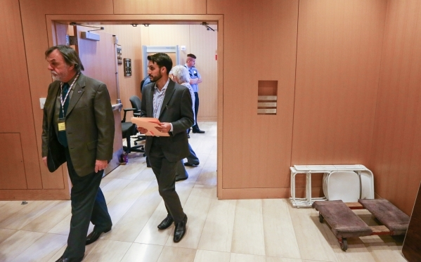 Nick Phillips, a candidate for Nevada Republican Party Chairman, second from left, enters the council chambers for a meeting of the Nevada Republican Central Committee at Las Vegas City Hall on Sa ...