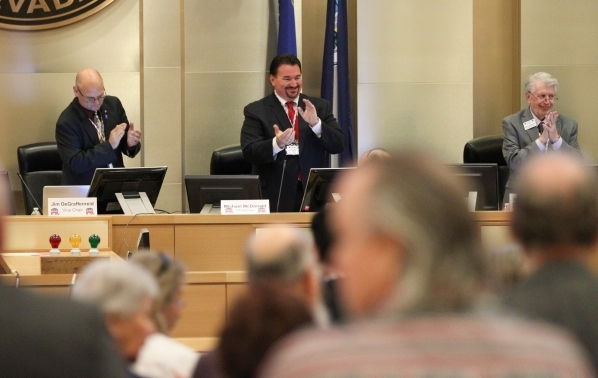 Nevada Republican Party Chairman Michael McDonald, center, claps during a meeting of the Nevada Republican Central Committee at Las Vegas City Hall on Saturday, Nov. 14, 2015. Chase Stevens/Las Ve ...