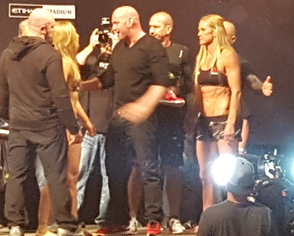 UFC president Dana White, center, steps between Ronda Rousey, left, and Holly Holm during the weigh in prior to their Saturday night fight in Melbourne, Australia. Adam Hill/Las Vegas Review-Journal