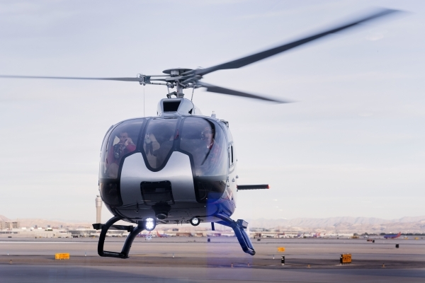 A helicopter is shown hovering outside of the new Maverick Helicopters terminal at 6075 Las Vegas Blvd. South on Tuesday, Nov. 17, 2015. Bill Hughes/Las Vegas Review-Journal