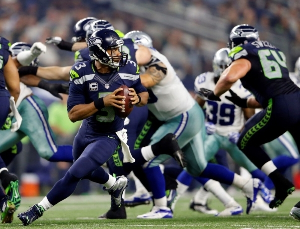 Seahawks quarterback Russell Wilson drops back to pass against the Dallas Cowboys on Nov. 1 at Arlington, Texas. Wilson helped Seattle to back-to-back wins before its bye to lift the team to 4-4 h ...