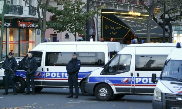 Police vehicles block the street in front of the Bataclan concert hall the morning after a series of deadly attacks in Paris , November 14, 2015.  (Reuters/Charles Platiau)