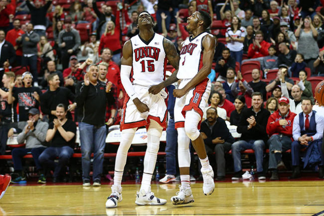 UNLV forward Dwayne Morgan (15) and UNLV forward Derrick Jones Jr. (1) celebrate a dunk by Jones against Southern Utah during a basketball game at the Thomas & Mack Center in Las Vegas on Wedn ...