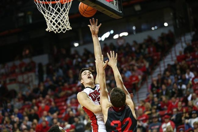 UNLV forward Stephen Zimmerman Jr. (33) shoots over Southern Utah's Casey Oliverson (32) during a basketball game at the Thomas & Mack Center in Las Vegas on Wednesday, Nov. 18, 2015. Ch ...