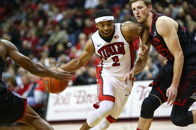UNLV guard Jerome Seagears (2) drives the ball against Southern Utah's A.J. Hess during a basketball game at the Thomas & Mack Center in Las Vegas on Wednesday, Nov. 18, 2015. Chase Stev ...