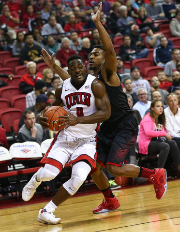 UNLV guard Ike Nwamu (0) drives the ball past Southern Utah during a basketball game at the Thomas & Mack Center in Las Vegas on Wednesday, Nov. 18, 2015. Chase Stevens/Las Vegas Review-Journa ...