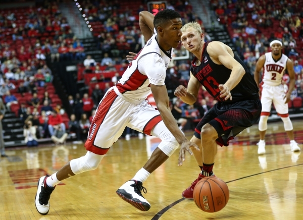 UNLV guard Patrick McCaw (22) drives the ball against Southern Utah's Race Parsons (13) at the Thomas & Mack Center in Las Vegas on Wednesday, Nov. 18, 2015. Chase Stevens/Las Vegas Revi ...