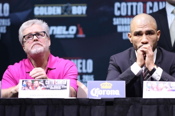 """Freddie Roach, left, and Miguel Cotto sit during the final press conference for Saul """"Canelo"""" Alvarez and Cotto at Mandalay Bay casino-hotel in Las Vegas Wednesday, Nov. 18, 2015. Erik V ..."""