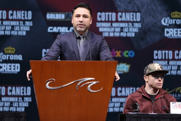 """Boxing promoter Oscar De La Hoya speaks during the final press conference for Saul """"Canelo"""" Alvarez and Miguel Cotto at Mandalay Bay casino-hotel in Las Vegas Wednesday, Nov. 18, 2015. E ..."""