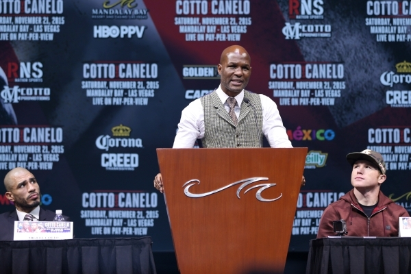 """Former boxer Bernard Hopkins, center, speaks during the final press conference for Miguel Cotto, left, and Saul """"Canelo"""" Alvarez at Mandalay Bay casino-hotel in Las Vegas Wednesday, Nov. ..."""