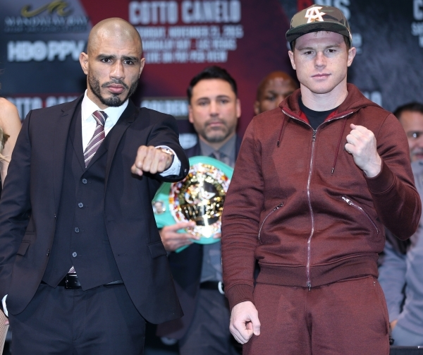 Miguel Cotto, left, and Canelo Alvarez pose during the final press conference at Mandalay Bay casino-hotel in Las Vegas Wednesday, Nob. 18, 2015. Canelo and Cotto will fight Saturday for the World ...