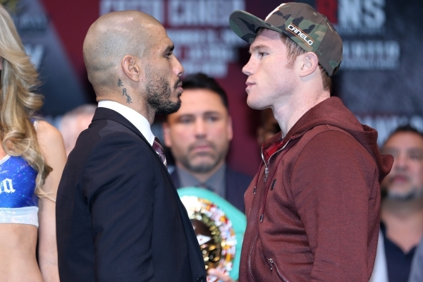 Miguel Cotto, left, and Canelo Alvarez face off during the final press conference at Mandalay Bay casino-hotel in Las Vegas Wednesday, Nob. 18, 2015. Canelo and Cotto will fight Saturday for the W ...