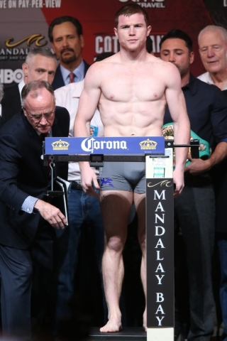 """Saul """"Canelo"""" Alvarez stands on the scale during his weigh in for his fight against Miguel Cotto at Mandalay Bay Convention Center in Las Vegas Friday, Nov. 20, 2015. Erik Verduzco/Las V ..."""