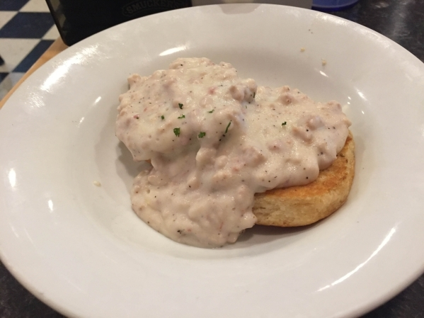 Homemade buttermilk biscuits smothered in Mamas sausage gravy are shown at Mr. Mamas. (Caitlyn Belcher/Special to View)