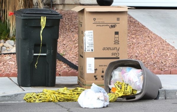 Crime tape is shown on Monday, Nov. 16, 2015 inside a trash bin near a crime scene where a man was found dead Sunday night in the 4500 block of Bonita Vista Street, near Peace Way and South Durang ...