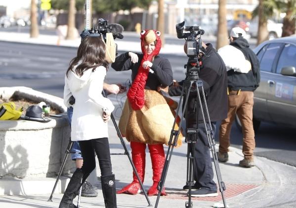 Trooper Chelsea Stuenkel, center, dressed as a turkey prepares to talk to members of the media on N. Eastern Avenue during pedestrian safety event on Wednesday, Nov. 18, 2015. Bizuayehu Tesfaye/La ...