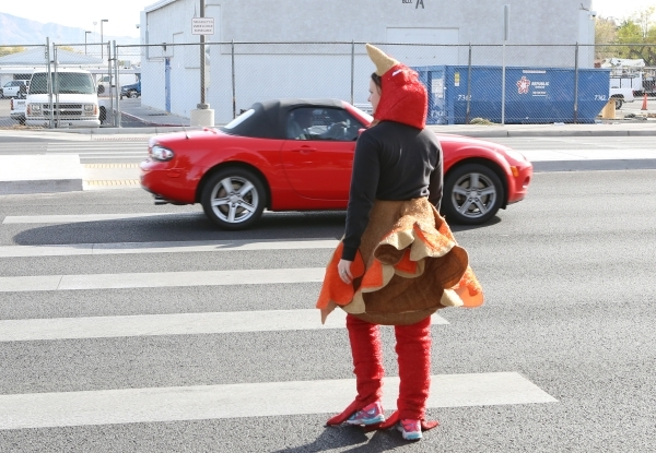 Trooper Chelsea Stuenkel dressed as a turkey crosses N. Eastern Avenue to see who fails to yield during pedestrian safety event on Wednesday, Nov. 18, 2015. The driver of the red Mazda was pulled  ...