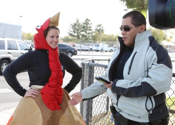 Trooper Chelsea Stuenkel, left, dressed as a turkey, talks to Trooper Loy Hixson during pedestrian safety event on N. Eastern Avenue Wednesday, Nov. 18, 2015. Bizuayehu Tesfaye/Las Vegas Review-Jo ...