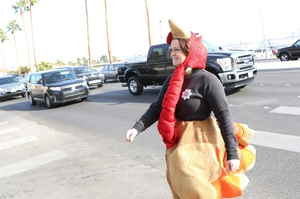 Trooper Chelsea Stuenkel dressed as a turkey crosses N. Eastern Avenue to see who fails to yield during pedestrian safety event on Wednesday, Nov. 18, 2015. Bizuayehu Tesfaye/Las Vegas Review-Jour ...